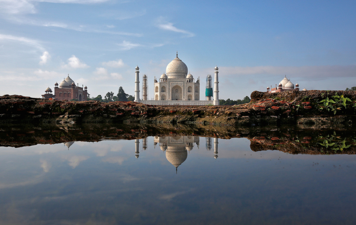 The Taj Mahal is reflected in a puddle in Agra, India, August 9, 2016. Reuters/Cathal McNaughton
