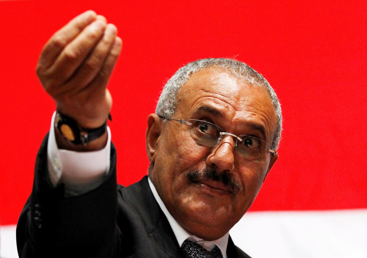 Yemen's then President Ali Abdullah Saleh gestures during a gathering of supporters in Sanaa