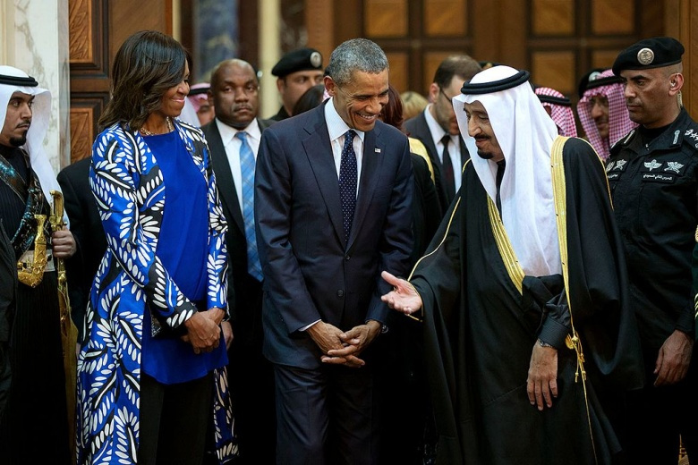 President Barack Obama and First Lady Michelle Obama walk with King Salman. Wikimedia Commons/Pete Souza
