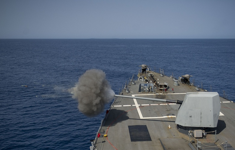 The guided-missile destroyer USS Mason fires its 5-inch light weight gun during a U.S.-China counter piracy exercise. Flickr/U.S. Naval Forces Central Command/U.S. Fifth Fleet