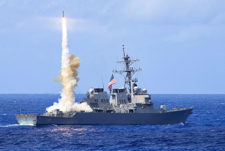 Arleigh Burke–class guided-missile destroyer USS Curtis Wilbur during a missile firing exercise​. Flickr/DVIDSHUB