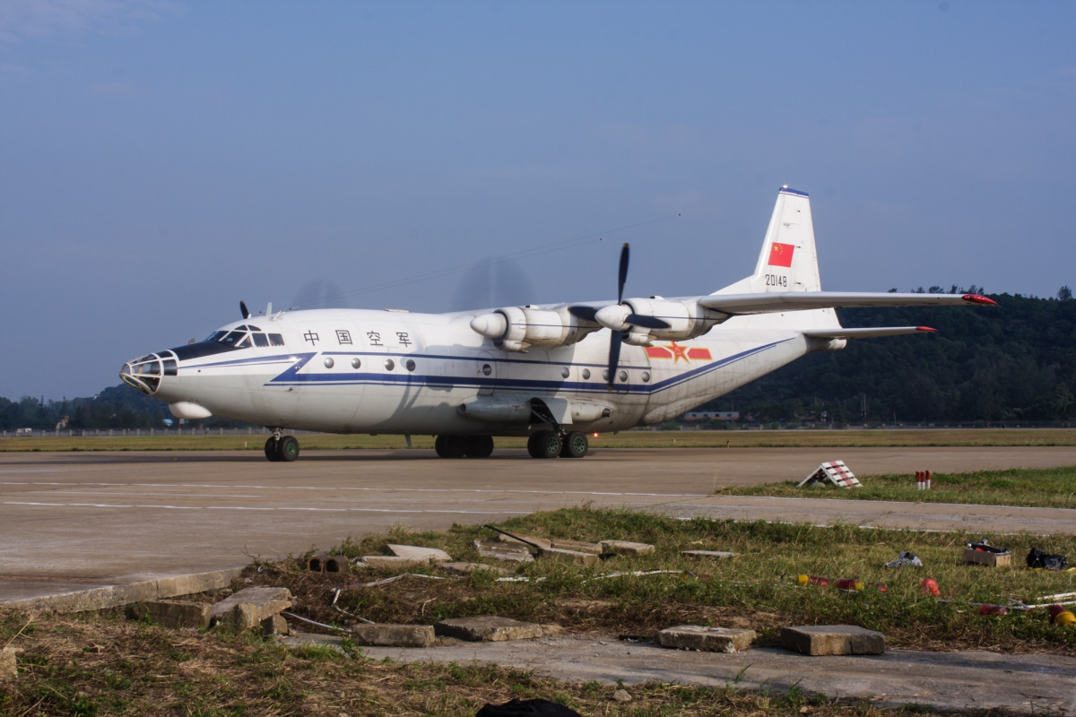 China lands plane on disputed island