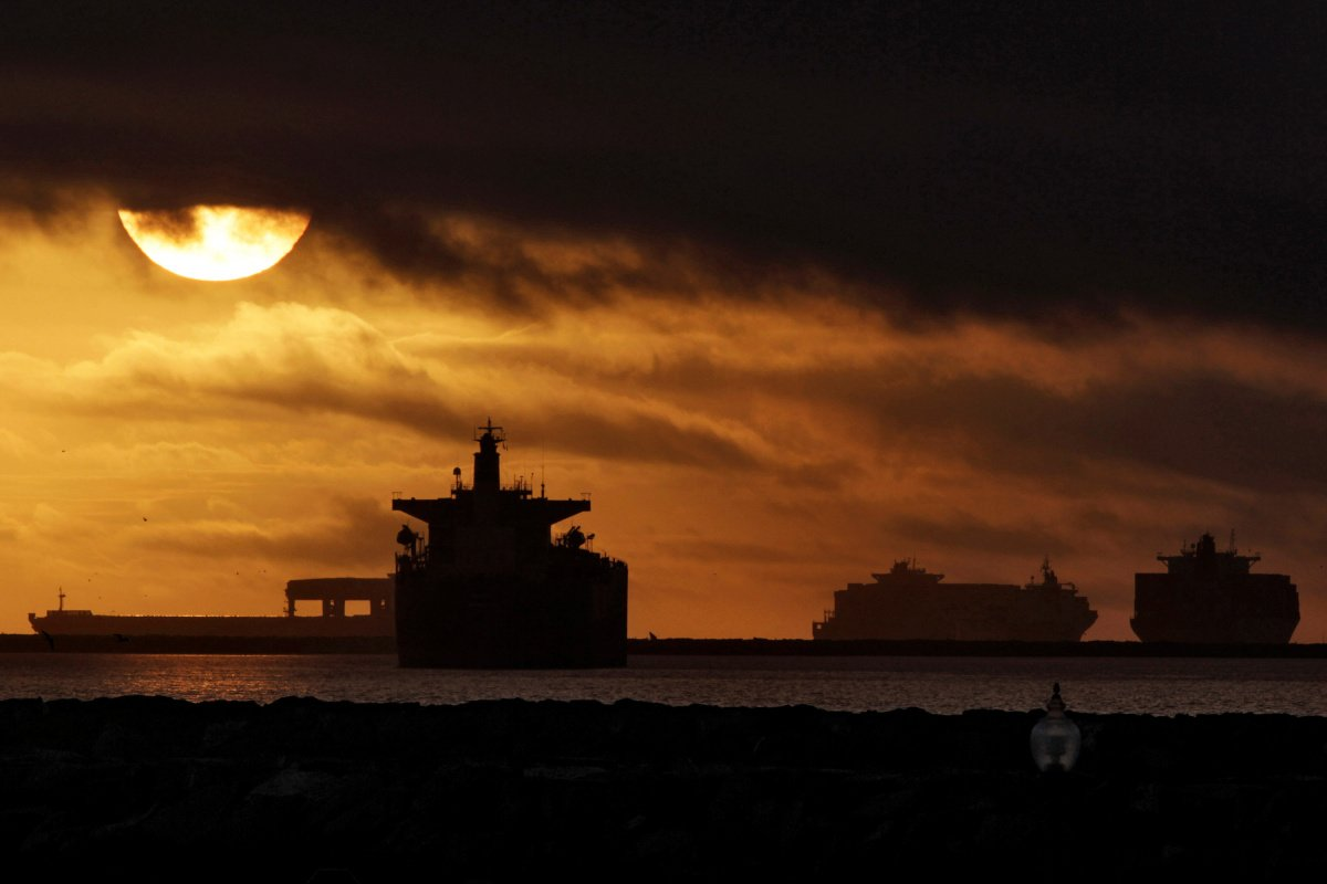 Anchored container ships and with other vessels sit offshore near the ports of Los Angeles and Long Beach