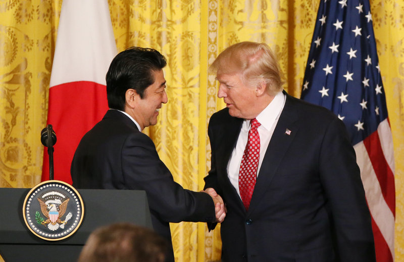 Prime Minister Shinzō Abe and President Donald Trump shaking hands on February 10, 2017. Wikimedia Commons/Creative Commons