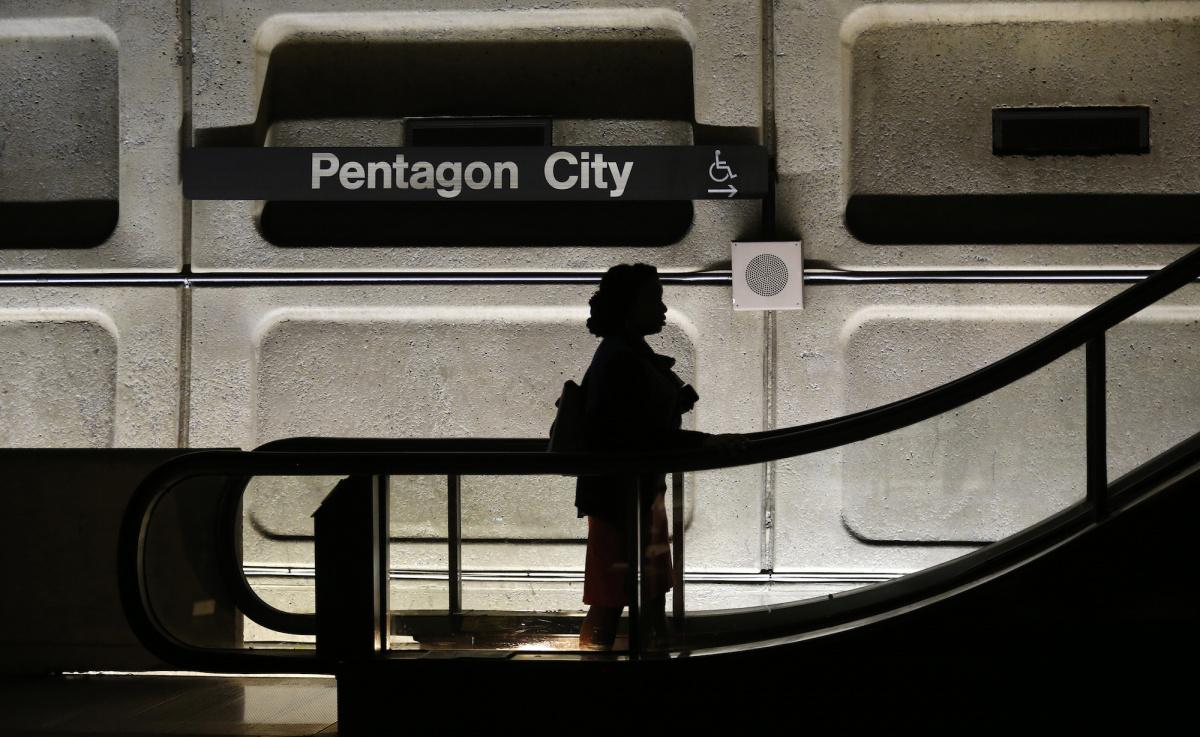 A woman rides at Pentagon City Metro station in Washington, October 2, 2013. Reuters/Kevin Lamarque