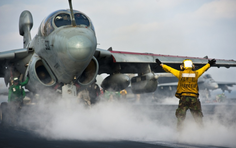 A sailor directs an EA-6B Prowler aboard the Nimitz-class aircraft carrier USS John C. Stennis. Flickr/U.S. Navy