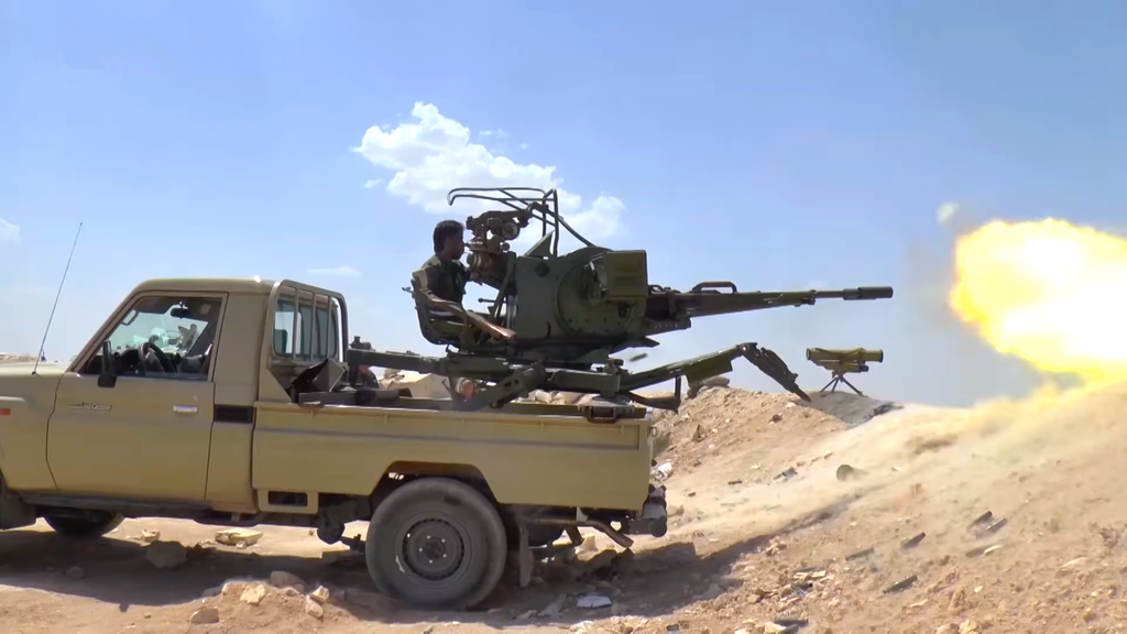 A Syrian Army ZU-23-2 firing at ISIS positions near the Ithriyah-Raqqa Highway. Wikimedia Commons/Creative Commons/Abkhazian Network News Agency