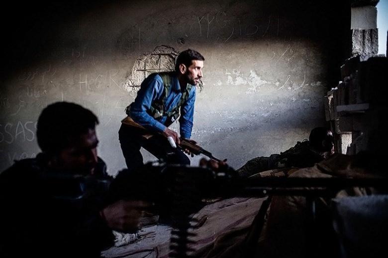 Fighting between Kurdish gunmen and Jabhat al-Nusra in Ras al-Ayn, Syria. Wikimedia Commons/Younes Mohammad