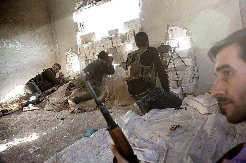 Fighting between Kurdish gunmen and al-Nusra Front in the town of Ras al-Ayn, Syria. Wikimedia Commons/Tasnim News/Younes Mohammad