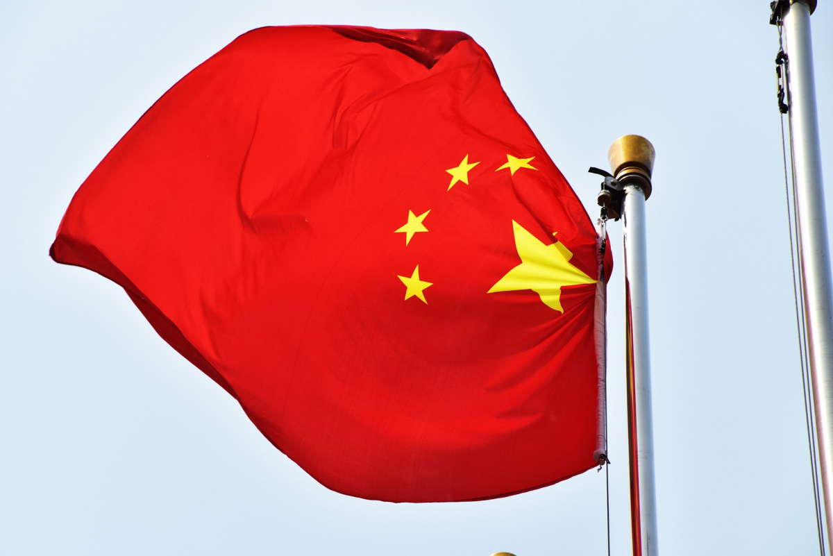 A Chinese flag flutters in the wind.