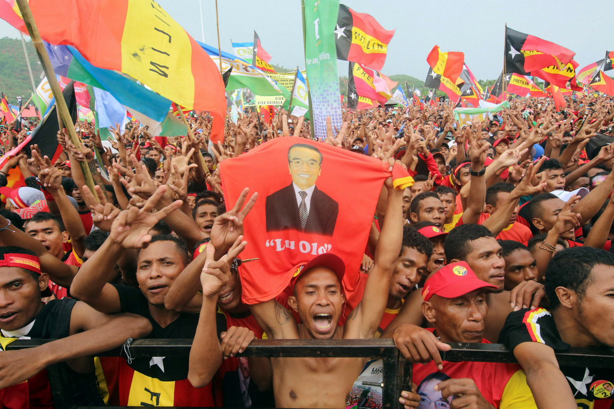 Supporters of presidential candidate Francisco Guterres of the Revolutionary Front for an Independent East Timor (FRETILIN) party cheer at a campaign rally ahead of next week's elections, in Tasi Tolu, Dili, East Timor