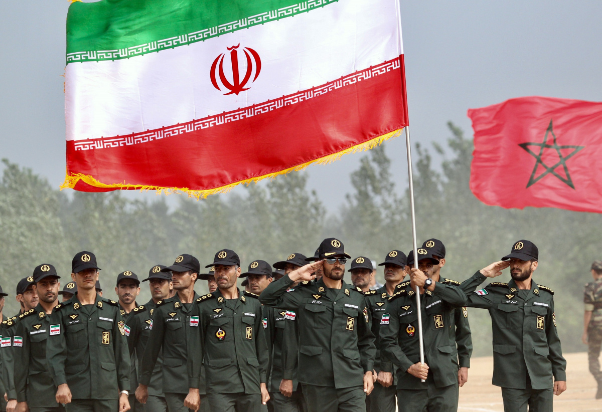 Iran's army servicemen with the national flag attend the opening ceremony of the airborne platoon competition, part of the International Army Games 2017, in Guangshui, Hubei province, China