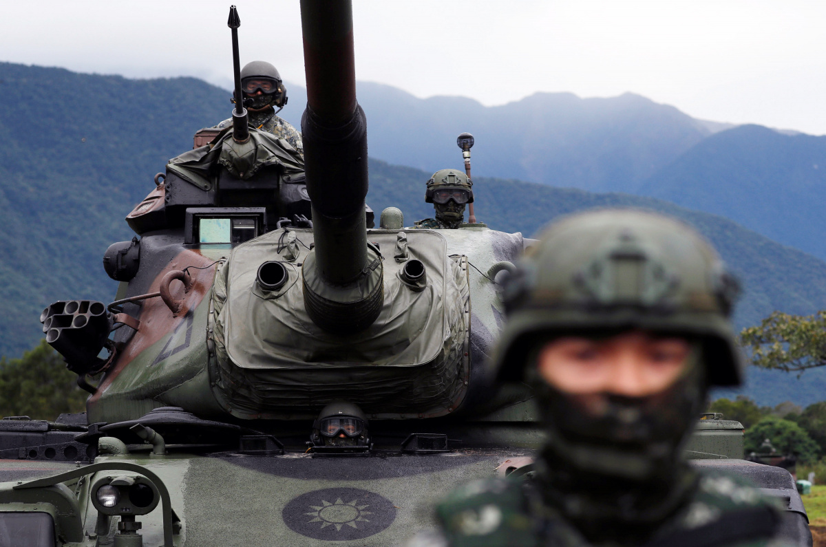 A Taiwanese soldier stands in front of a M60A3 tank during a military drill in Hualien, eastern Taiwan