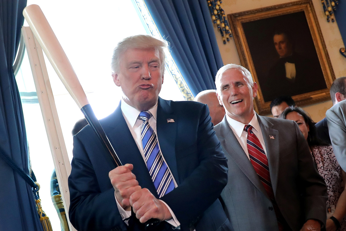 Vice President Mike Pence laughs as U.S. President Donald Trump holds a baseball bat as they attend a Made in America product showcase event at the White House in Washingto