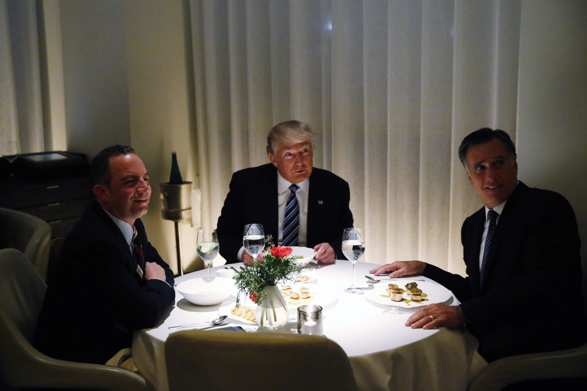 U.S. President-elect Donald Trump sits at a table for dinner with former Massachusetts Governor Mitt Romney (R) and his choice for White House Chief of Staff Reince Priebus (L) at Jean-Georges at the Trump International Hotel & Tower in New York