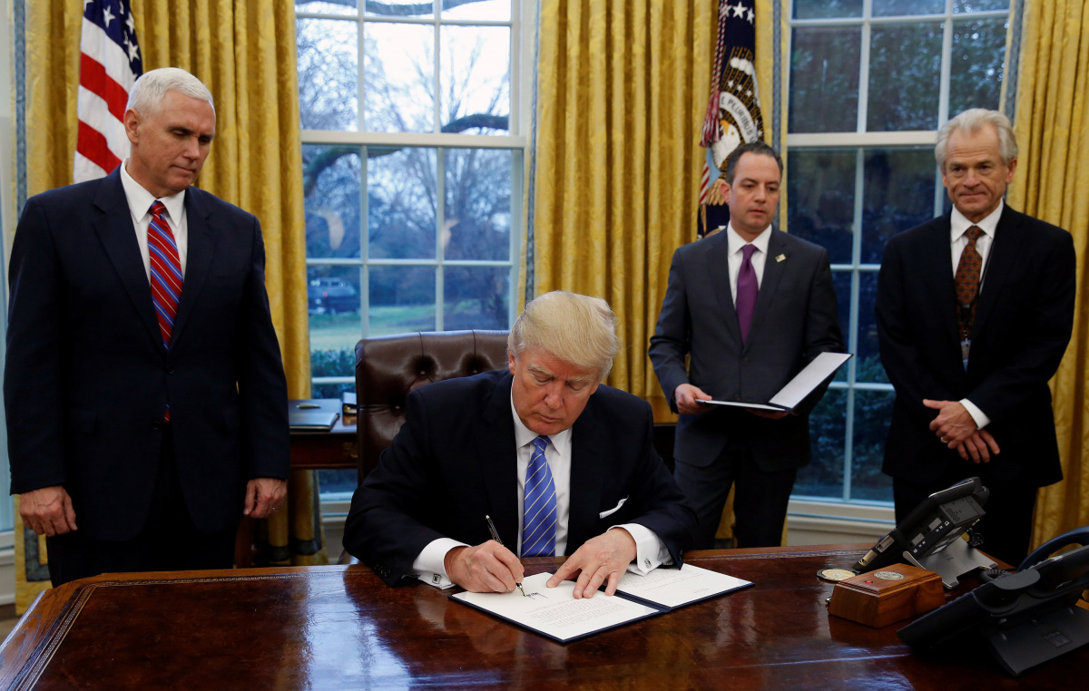 U.S. President Donald Trump signs the executive order for the reinstatement of the Mexico City Policy in the Oval Office of the White House in Washington