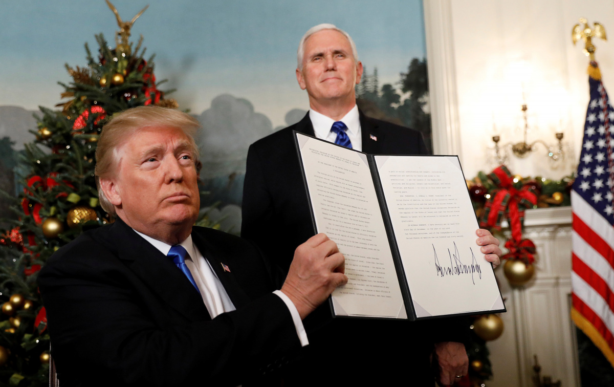 After signing, U.S. President Donald Trump holds up the proclamation that the United States recognizes Jerusalem as the capital of Israel and will move its embassy there, during an address from the White House in Washington