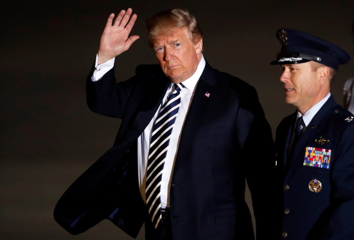 President Donald Trump waves as he arrives to greet the three Americans formerly held hostage in North Korea, at Joint Base Andrews