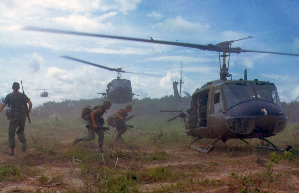 """U.S. Army Bell UH-1D helicopters airlift members of the 2nd Battalion, 14th Infantry Regiment from the Filhol Rubber Plantation area to a new staging area, during Operation """"Wahiawa"""", a search and destroy mission conducted by the 25th Infantry Division, northeast of Cu Chi, South Vietnam, 1966."""