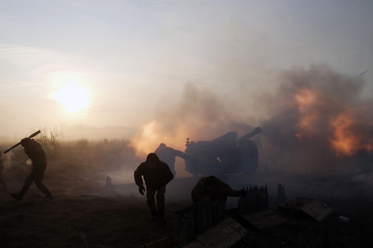 Ukrainian servicemen fire an artillery weapon in the direction of positions of the armed forces of the separatist self-proclaimed Donetsk People's Republic near Novoluhanske in Donetsk region, Ukraine