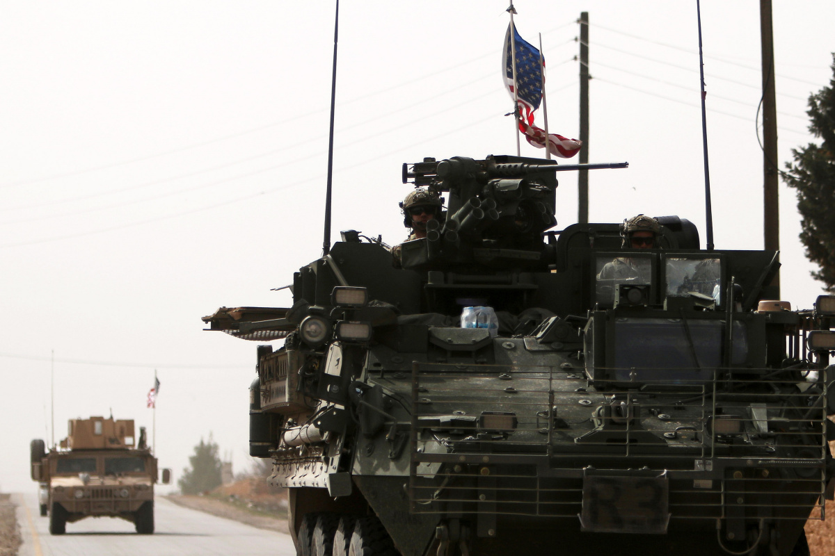American army vehicles drive north of Manbij city, in Aleppo Governorate, Syria
