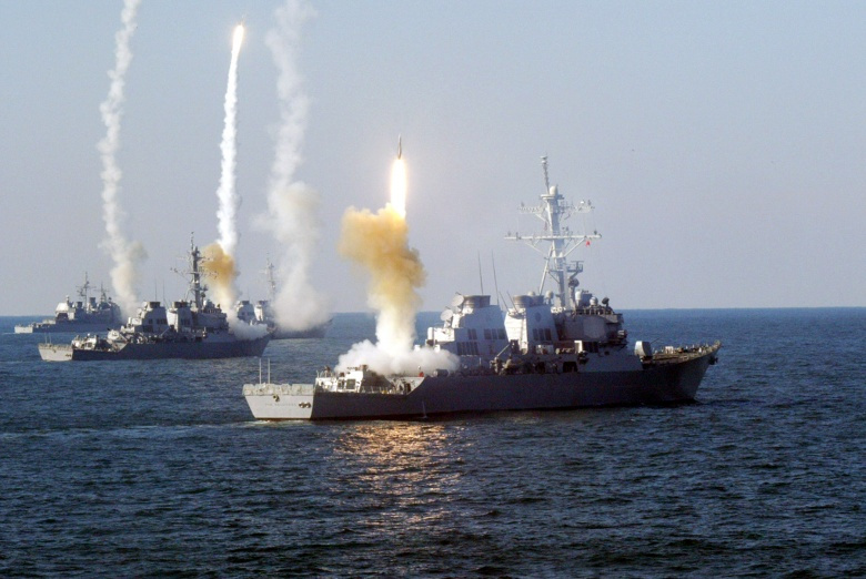 Image: US ships firing missiles. Wikimedia Commons/public domain.
