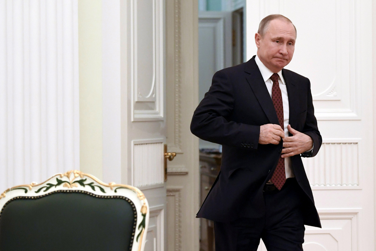 Russian President Putin enters a hall to meet with candidates who participated in the last presidential election, at the Kremlin in Moscow