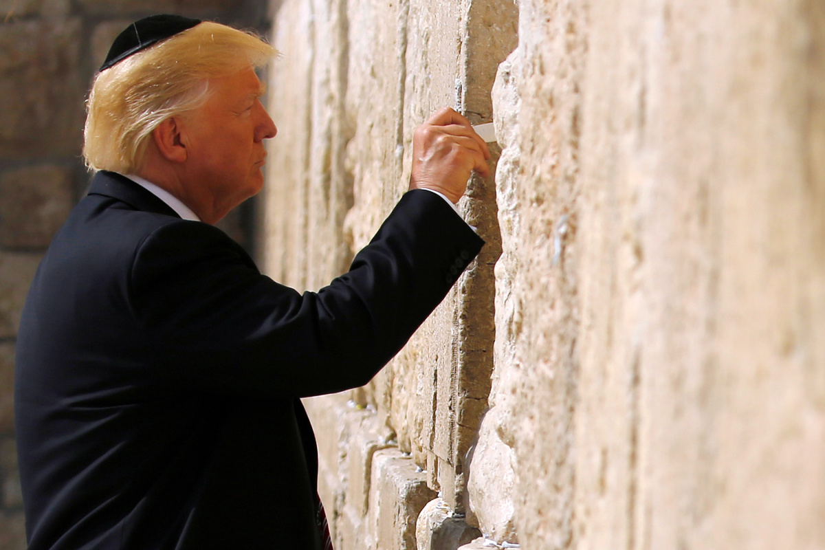 U.S. President Donald Trump leaves a note at the Western Wall in Jerusalem