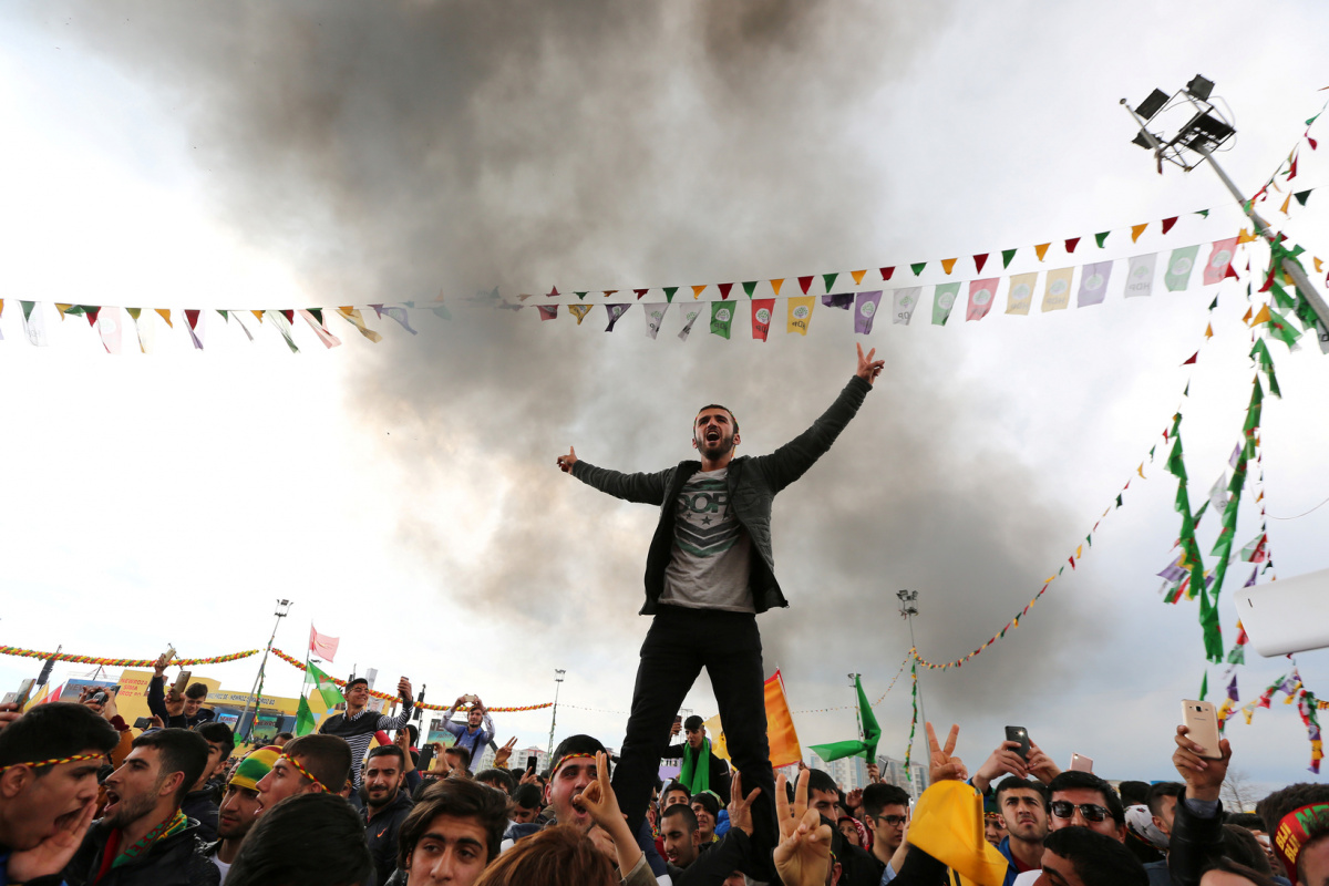 People gesture during a gathering celebrating Newroz, which marks the arrival of spring and the new year, in the Kurdish-dominated southeastern city of Diyarbakir, Turkey, March 21, 2017. REUTERS/Sertac Kayar