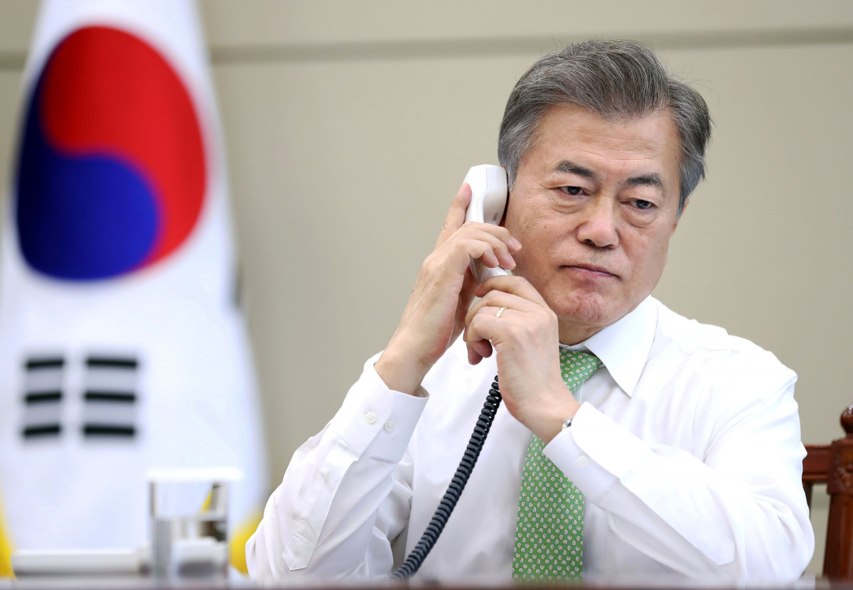South Korean President Moon Jae-in talks on the phone to Chinese President Xi Jinping at the Presidential Blue House in Seoul