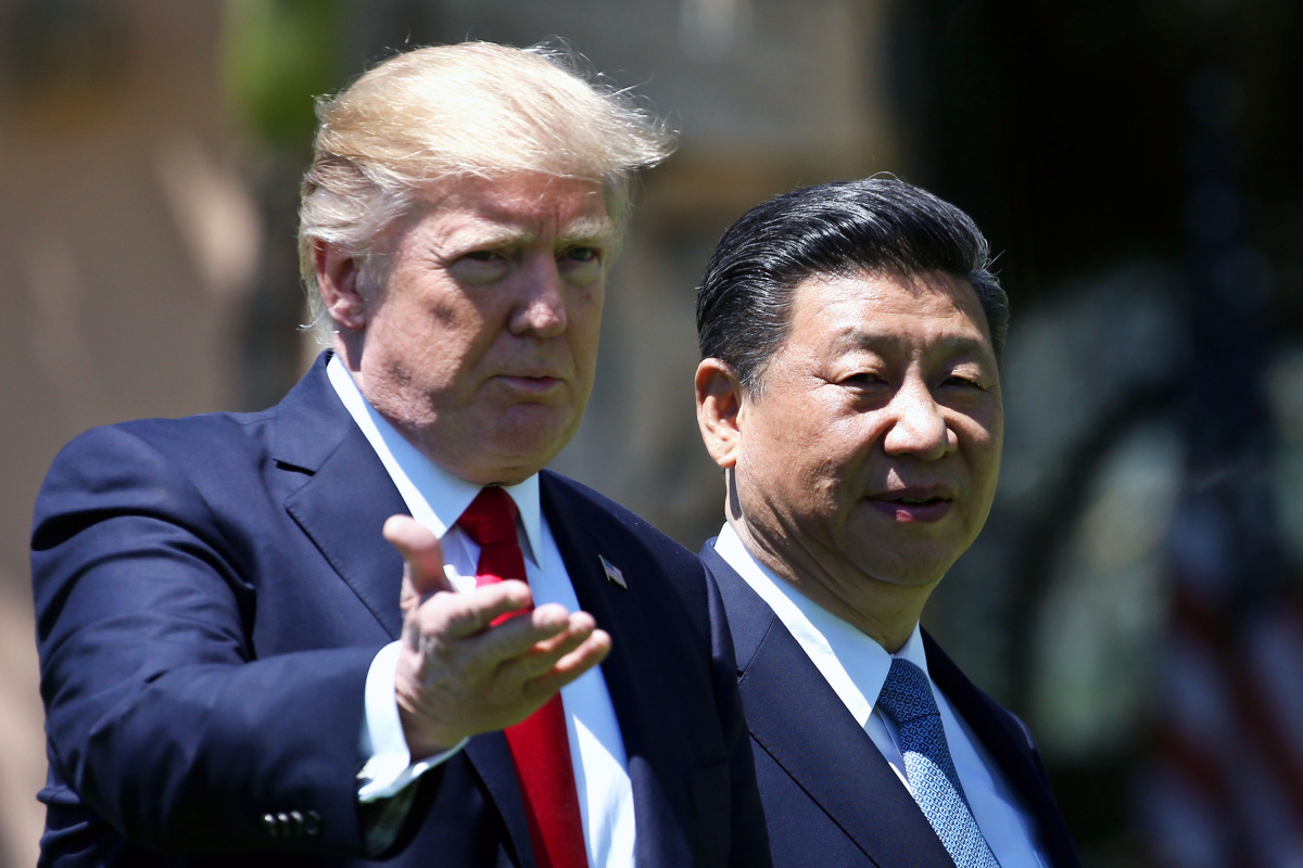 U.S. President Donald Trump and China's President Xi Jinping chat as they walk along the front patio of the Mar-a-Lago estate after a bilateral meeting in Palm Beach, Florida