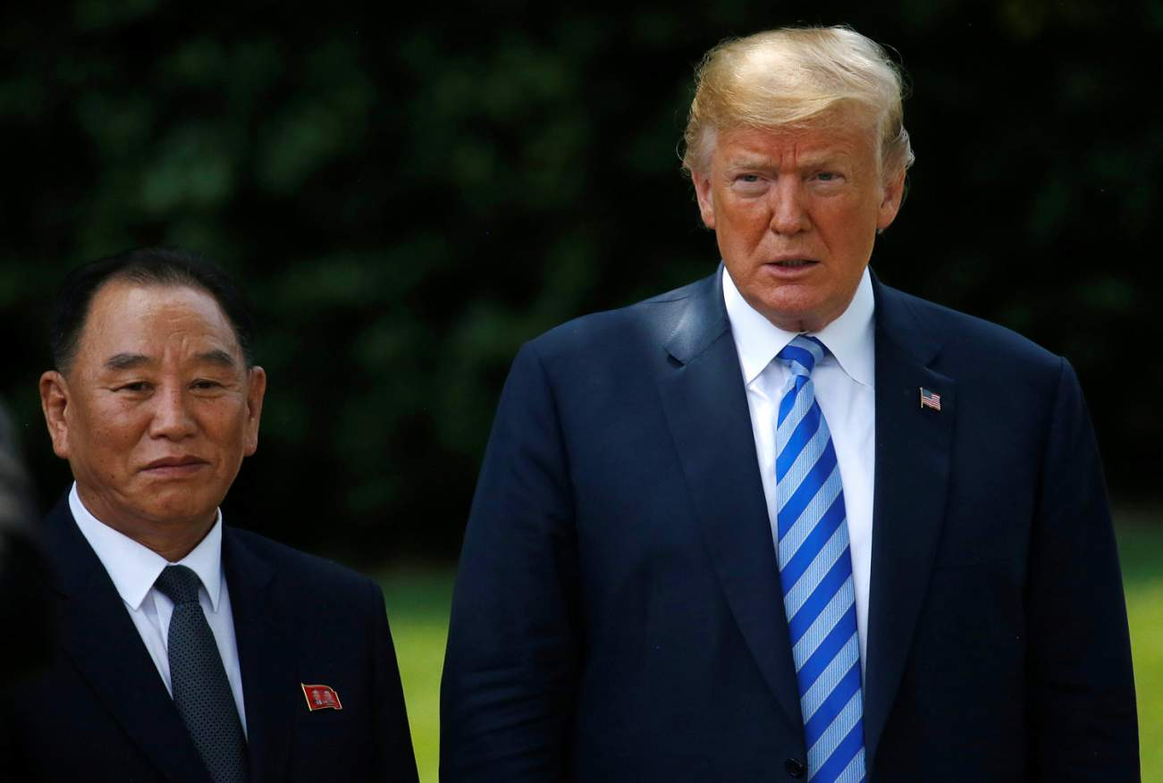 North Korea's envoy Kim Yong Chol poses with U.S. President Donald Trump for a photo by an official photographer as he departs after a meeting at the White House in Washington, U.S., June 1, 2018. REUTERS/Leah Millis