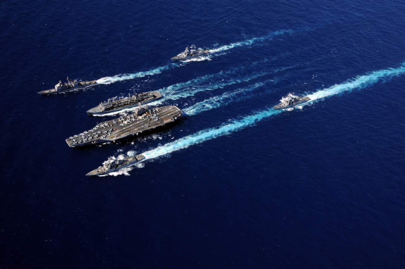 The aircraft carrier USS Abraham Lincoln (CVN 72), bottom center, and the Military Sealift Command fast combat support ship USNS Rainier (T-AOE 7), top center, cruise in formation with ships from the Abraham Lincoln Carrier Strike Group during an underway replenishment in the Pacific Ocean Sept. 19, 2010. The strike group was on deployment to the U.S. 7th and 5th Fleet areas of responsibility conducting maritime security operations and theater security cooperation efforts. (DoD photo by Mass Communication S