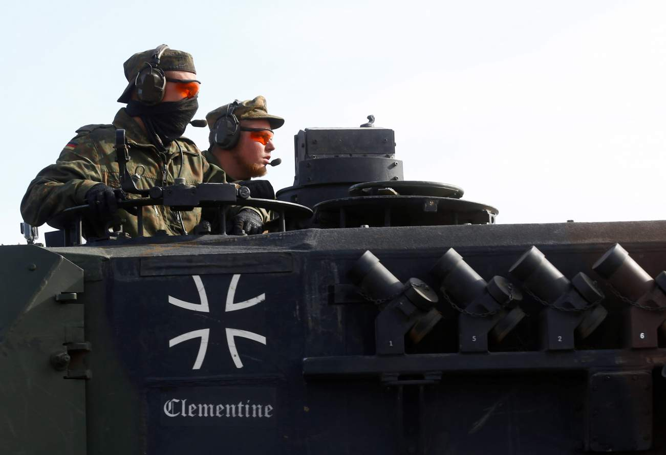 German army soldiers drive their battle tank Leopard 2 after NATO enchanced Forward Presence Battle Group Lithuania exercise in Pabrade military training field, Lithuania