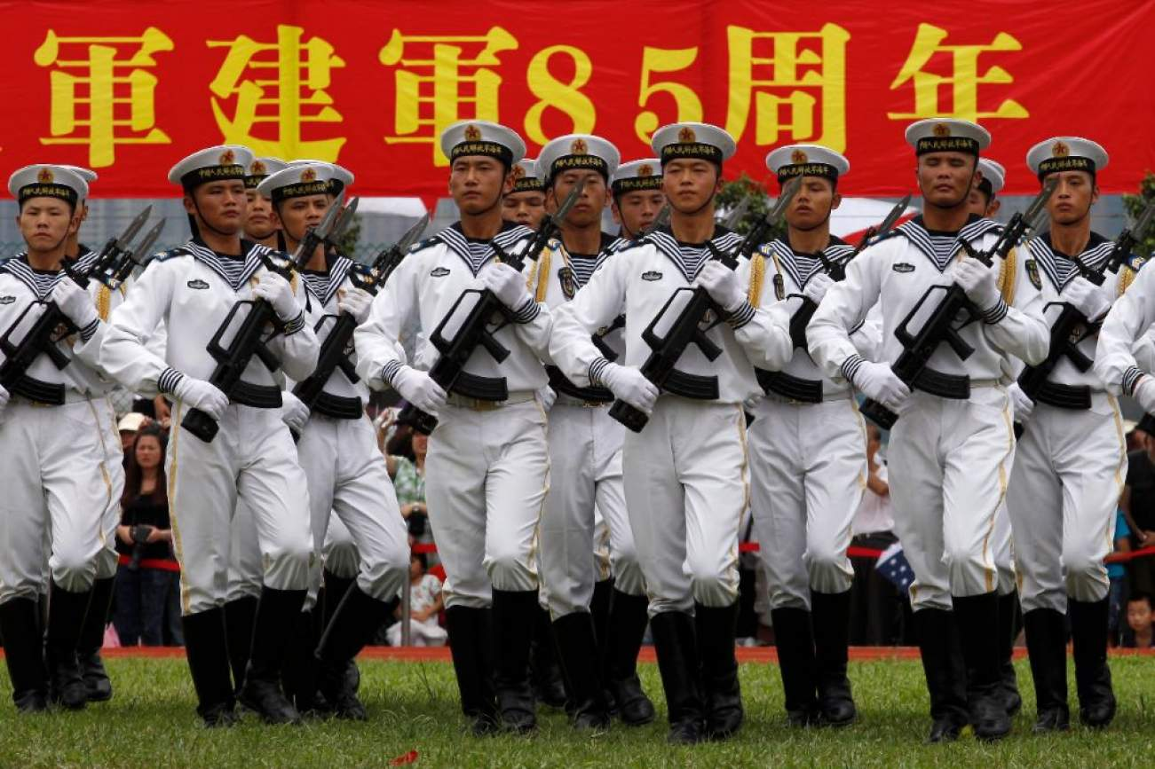 Chinese People's Liberation Army (PLA) navy sailors march during an open day at the Ngong Shuen Chau Naval Base on Hong Kong's Stonecutters Island July 28, 2012. The naval base was open to the public on Saturday, four days ahead of the PLA Army Day on August 1. REUTERS/Tyrone Siu