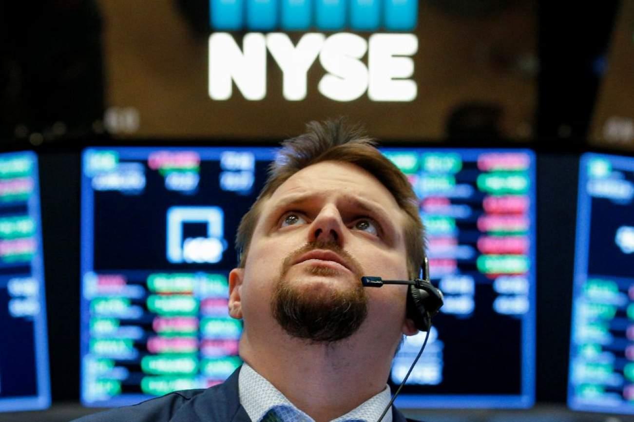 Traders work on the floor of the New York Stock Exchange, (NYSE) in New York, U.S., April 10, 2018. REUTERS/Brendan McDermid