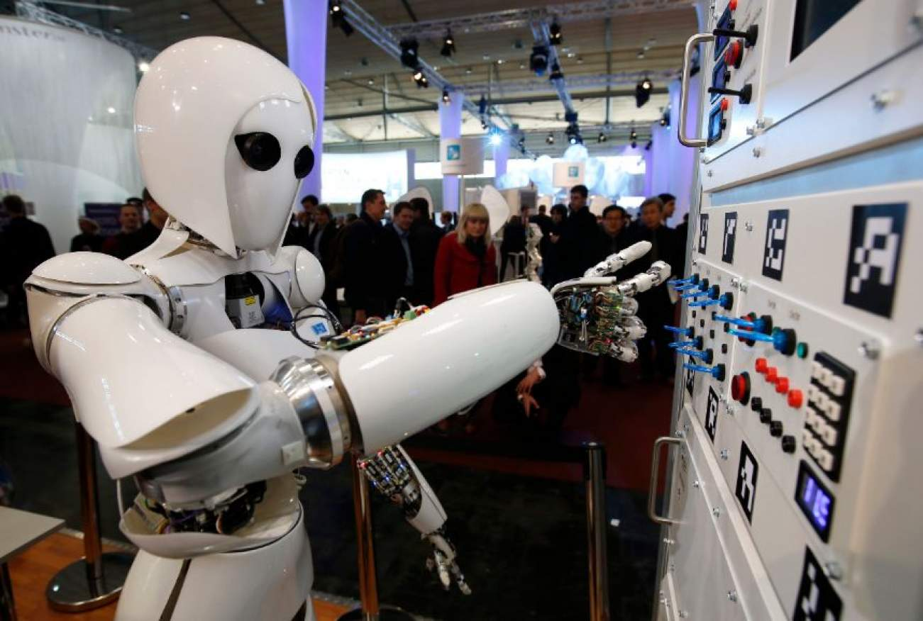 The humanoid robot AILA (artificial intelligence lightweight android) operates a switchboard during a demonstration by the German research centre for artificial intelligence at the CeBit computer fair in Hanover March, 5, 2013. The biggest fair of its kind open its doors to the public on March 5 and will run till March 9, 2013. REUTERS/Fabrizio Bensch