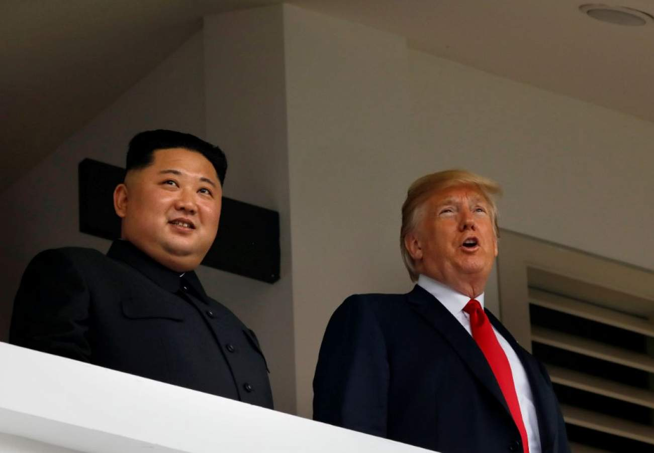 U.S. President Donald Trump and North Korea's leader Kim Jong Un hold a summit at the Capella Hotel on the resort island of Sentosa, Singapore June 12, 2018. REUTERS/Jonathan Ernst