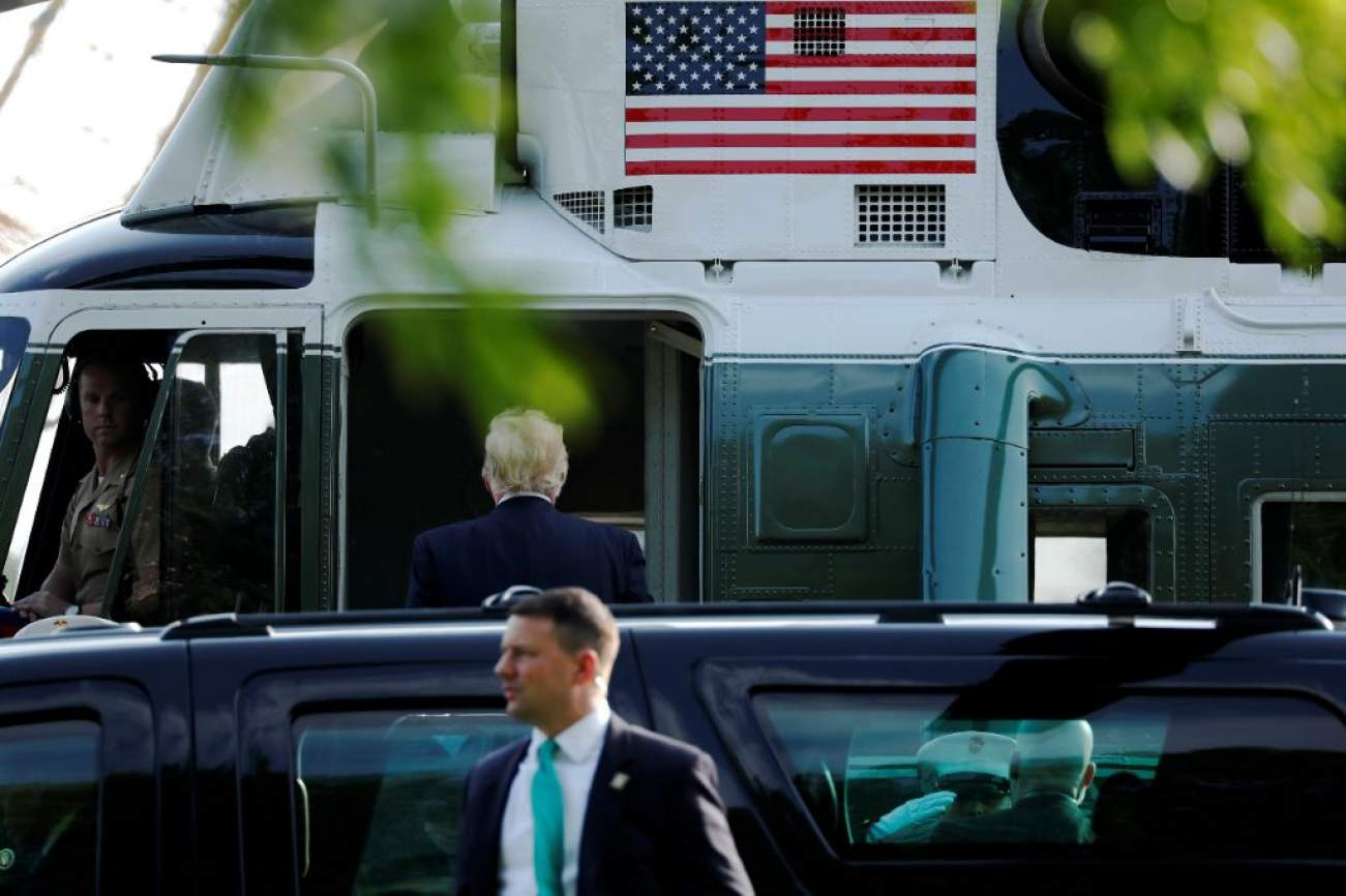U.S. President Donald Trump departs after visiting first lady Melania Trump at Walter Reed National Military Medical Center, where she is recovering from kidney surgery, in Bethesda, Maryland, U.S. May 15, 2018. REUTERS/Jonathan Ernst