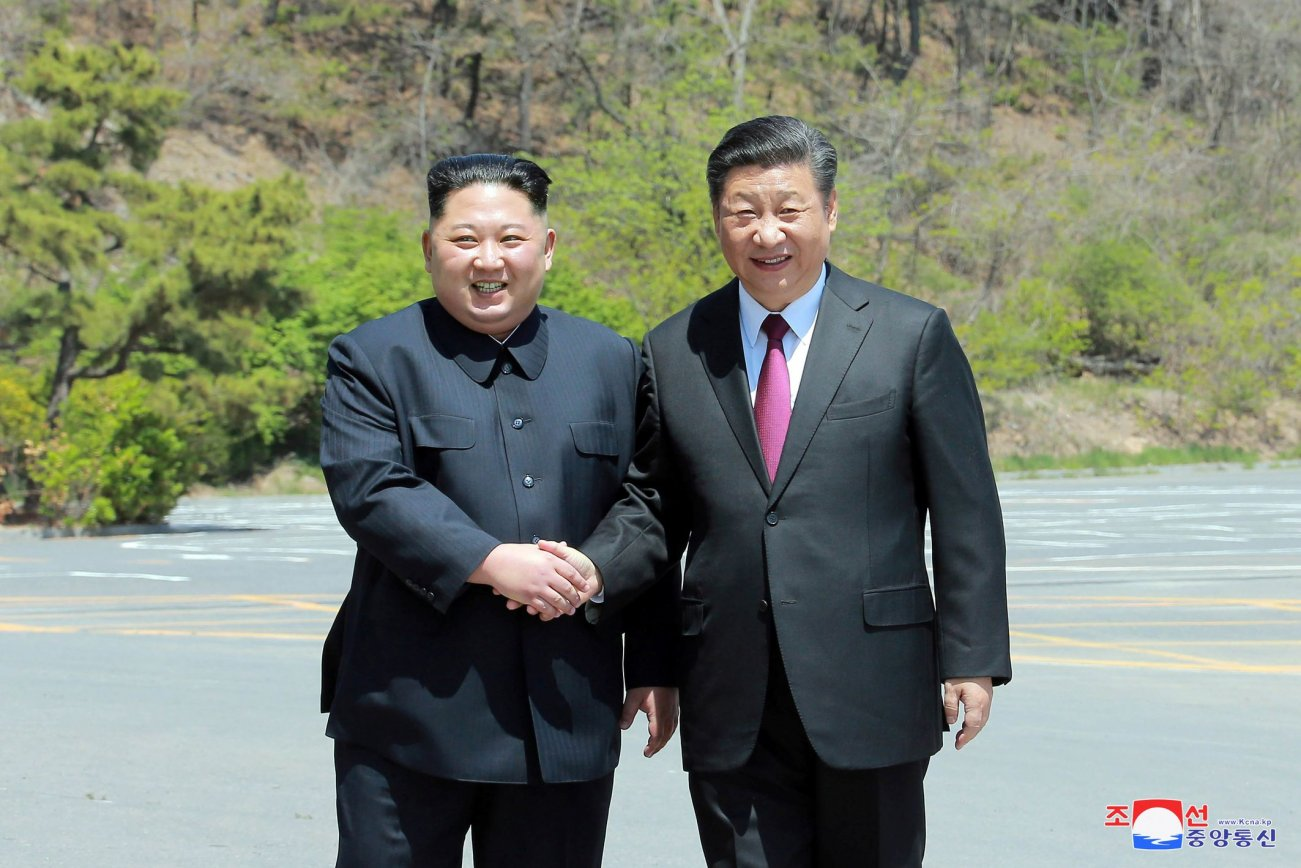 North Korean leader Kim Jong Un shakes hands with China's President Xi Jinping, in Dalian, China in this undated photo released on May 9, 2018 by North Korea's Korean Central News Agency (KCNA). KCNA/via REUTERS ATTENTION EDITORS - THIS PICTURE WAS PROVIDED BY A THIRD PARTY. REUTERS IS UNABLE TO INDEPENDENTLY VERIFY THE AUTHENTICITY, CONTENT, LOCATION OR DATE OF THIS IMAGE. THIS PICTURE IS DISTRIBUTED EXACTLY AS RECEIVED BY REUTERS, AS A SERVICE TO CLIENTS. NO THIRD PARTY SALES. NOT FOR USE BY REUTERS THIRD