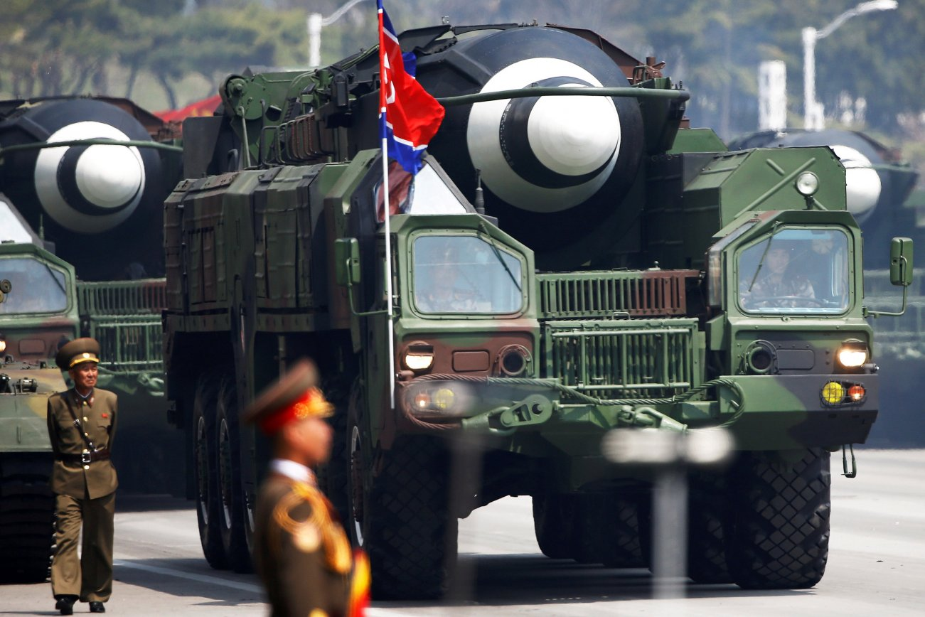 Missiles are driven past the stand with North Korean leader Kim Jong Un and other high ranking officials during a military parade marking the 105th birth anniversary of the country's founding father, Kim Il Sung in Pyongyang