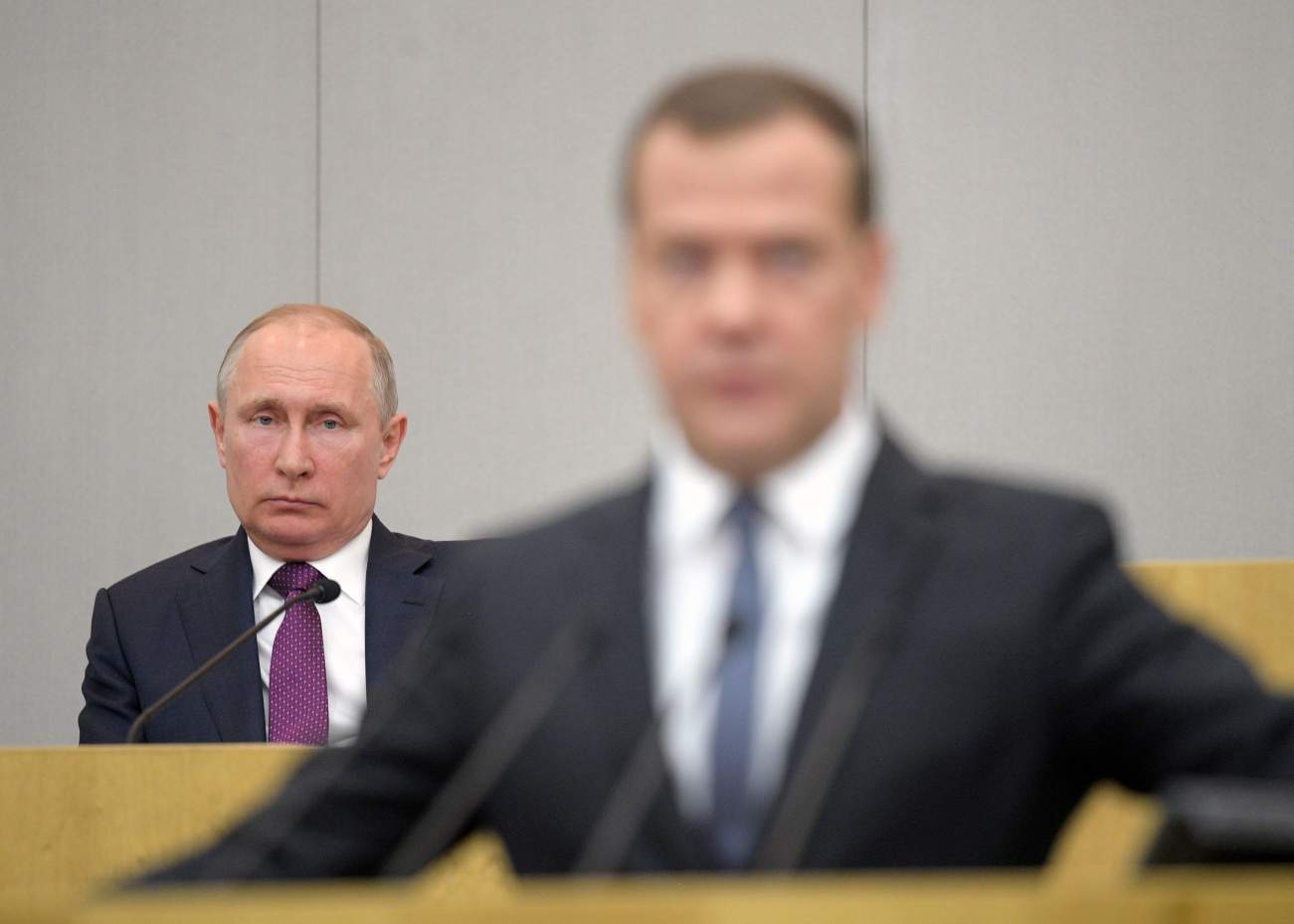 Dmitry Medvedev, who was nominated as the candidate for the post of Russian Prime Minister, and President Vladimir Putin attend a session of the State Duma in Moscow
