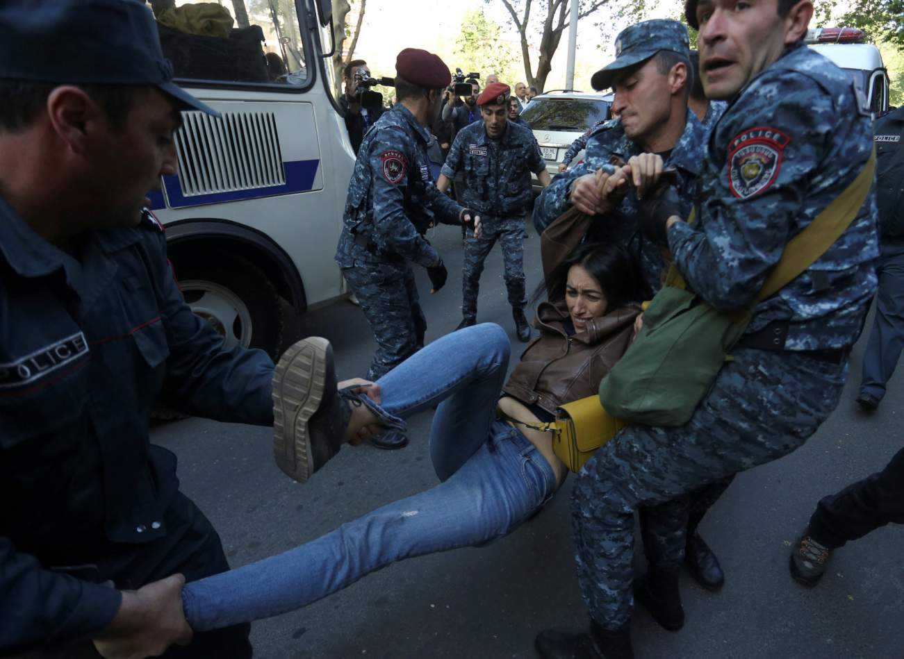 A demonstrator is detained by police during a protest after parliament voted to allow former president Serzh Sargsyan to become prime minister, in front of the Armenian government building in Yerevan, Armenia April 19, 2018. Photolure/Vahram Baghdasaryan via REUTERS