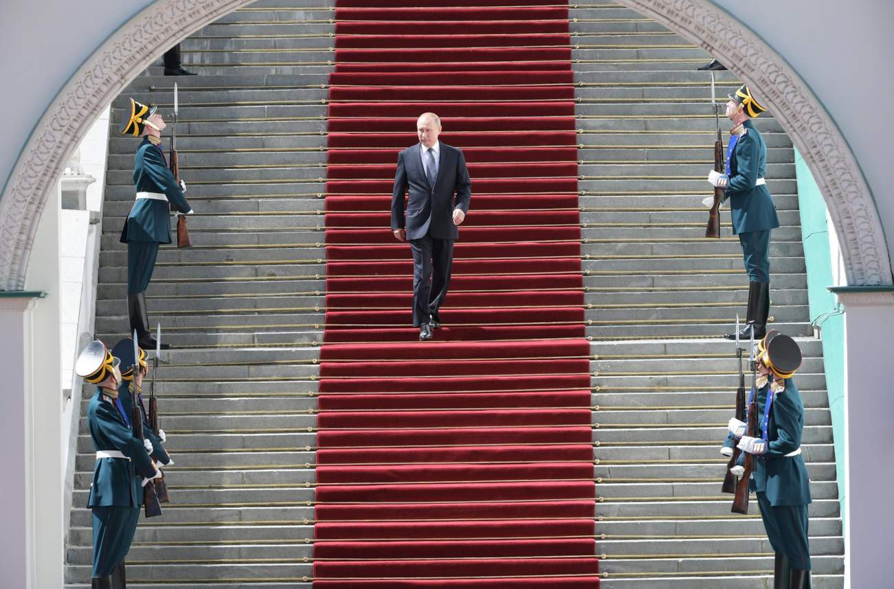 Russian President Vladimir Putin walks down the stairs after an inauguration ceremony in Cathedral Square at the Kremlin in Moscow, Russia May 7, 2018. Sputnik/Sergei Guneev/Pool via REUTERS