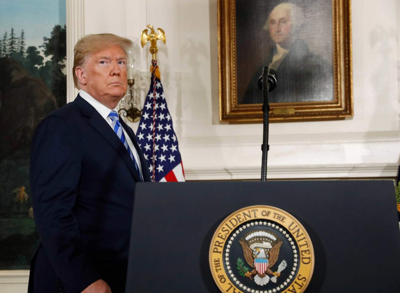 U.S. President Donald Trump arrives to announce his intention to withdraw from the JCPOA Iran nuclear agreement during a statement in the Diplomatic Room at the White House in Washington, U.S., May 8, 2018. REUTERS/Jonathan Ernst