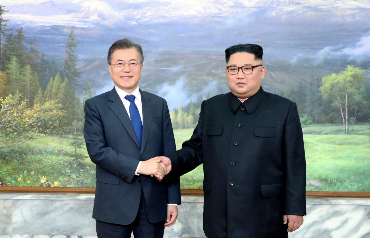 South Korean President Moon Jae-in shakes hands with North Korean leader Kim Jong Un during their summit at the truce village of Panmunjom, North Korea, in this handout picture provided by the Presidential Blue House on May 26, 2018.