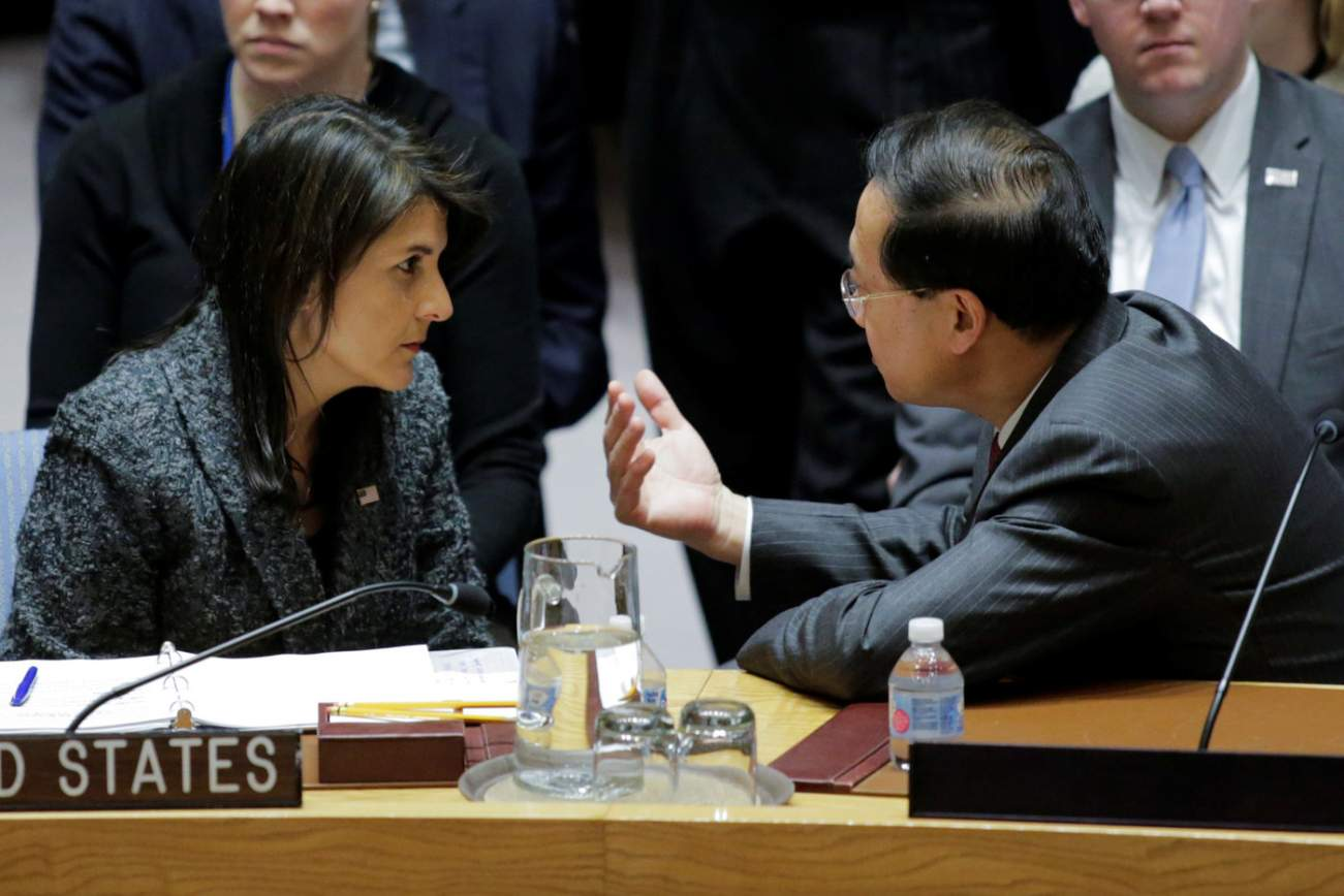 U.S. Ambassador to the United Nations Nikki Haley (L) speaks to China's ambassador to the U.N. Ma Zhaoxu before the United Nations Security Council vote for ceasefire to Syrian bombing in eastern Ghouta, at the United Nations headquarters in New York, U.S., February 24, 2018. REUTERS/Eduardo Munoz