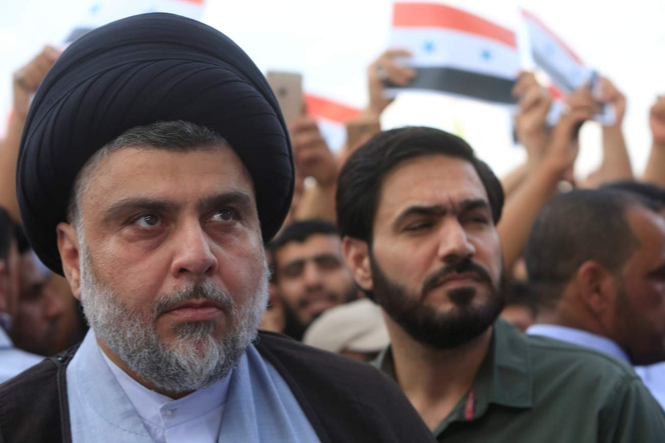 Iraqi Shi'ite cleric Moqtada al-Sadr attends a protest against western air strikes on Syria, in Najaf, Iraq April 15, 2018. REUTERS/Alaa Al-Marjani