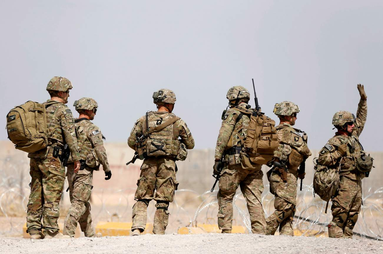 U.S. troops walk outside their base in Uruzgan province, Afghanistan