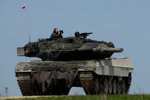 "Image: ""Polish soldiers, assigned to the 34th Armor Cavalry Brigade, conduct a Vehicle Identification exercise on their Polish Leopard tank, as part of the Strong Europe Tank Challenge (SETC), at the 7th Army Joint Multinational Training Command's Grafenwoehr Training Area, Grafenwoehr, Germany, May 10, 2016. The SETC is co-hosted by U.S. Army Europe and the German Bundeswehr, May 10-13, 2016. The competition is designed to foster military partnership while promoting NATO interoperability. Seven platoons fr"